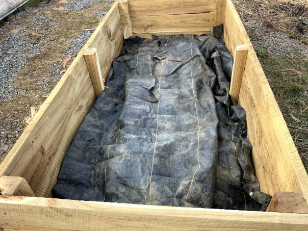 raised bed with weed barrier