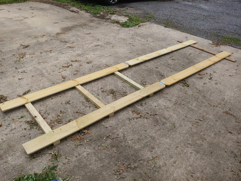 Laid flat with hinges connecting the top